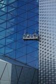 Workers washing the windows facade of a modern office building (cleaning gl — Photo