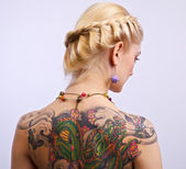 Portrait of sexy woman with tattoo on her back — Stock Photo