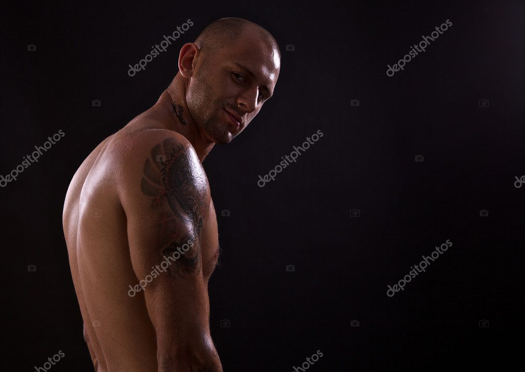 Young muscle bold male model in studio — Stock Photo #6524208
