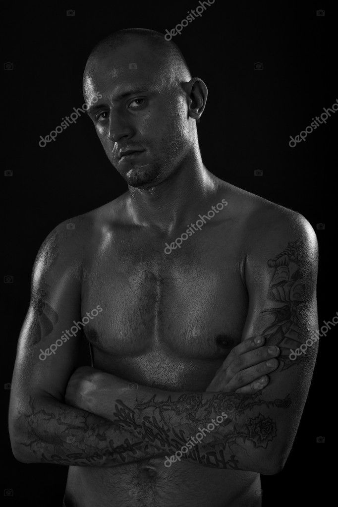 Young muscle bold male model in studio — Stock Photo #6524210