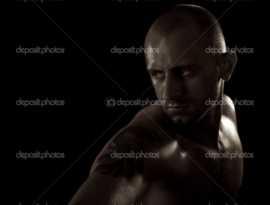 Young muscle bold male model in studio — Stock Photo #6524214