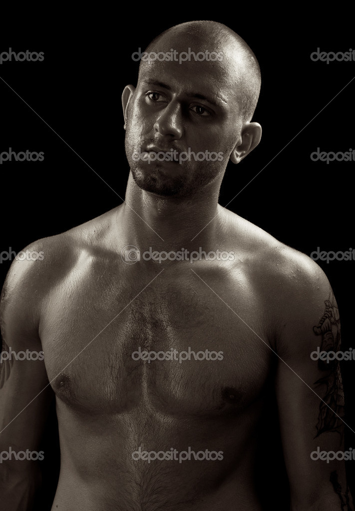 Young muscle bold male model in studio  Stockfoto #6524248