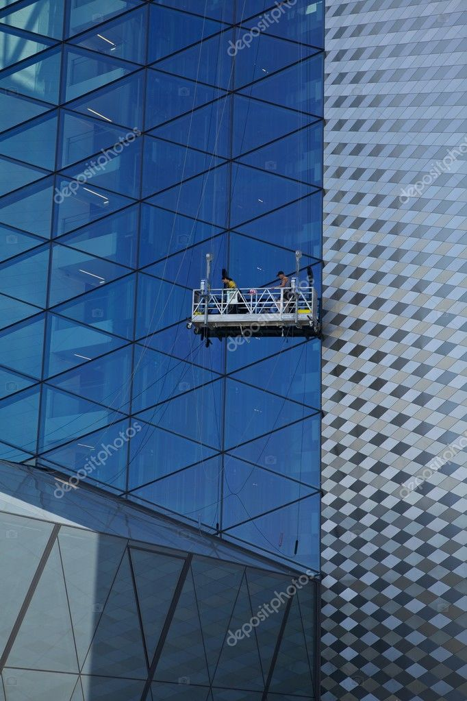 Workers washing the windows facade of a modern office building (cleaning glass service)  Stock Photo #6524325