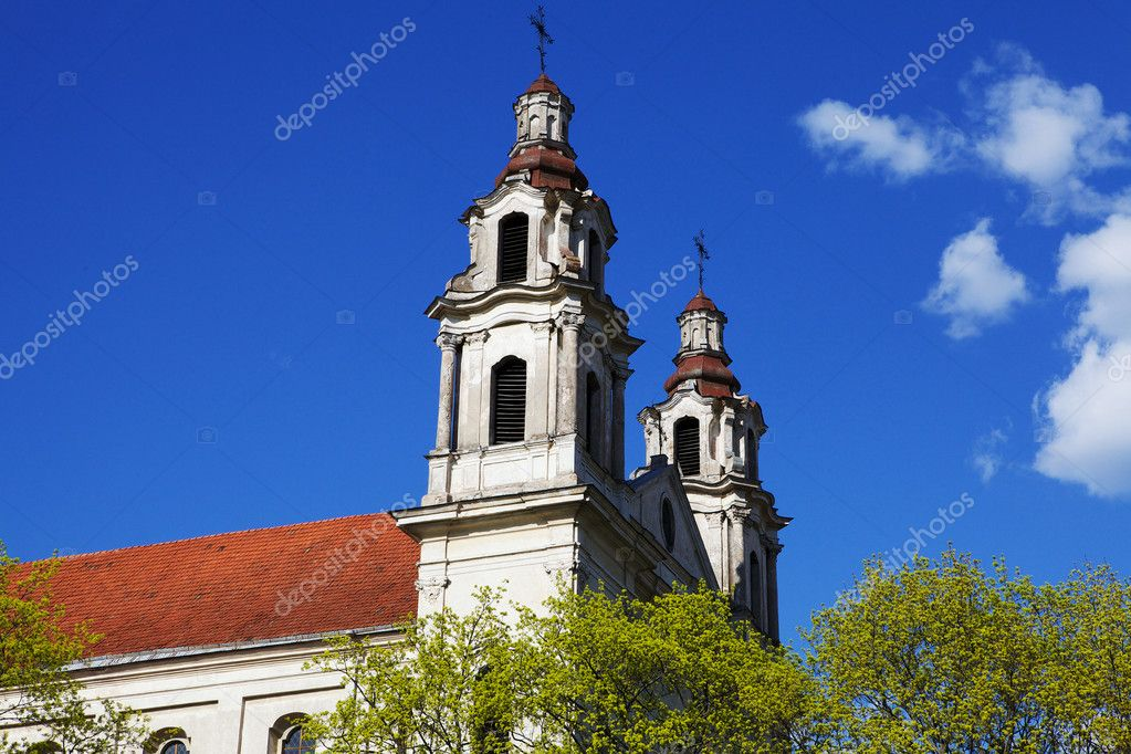Towers of an old catholic church reaching in to the sky — Stock Photo #6524570