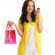 Young woman with a phone and bag — Stock Photo