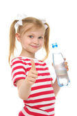 Happy girl with bottle of water smiling — Stock Photo