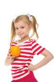 Girl drinking orange juice through straw — Stock Photo