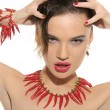 Sexy woman with jewelry of hot pepper — Stock Photo #6113824