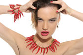 Sexy woman with jewelry of hot pepper — Stock Photo