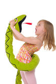 Girl fights with toy snake — Stock Photo