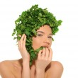 Beautiful woman with hat of parsley — Stock Photo