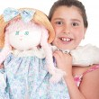 Little girl with doll — Stockfoto