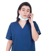 Doctor talking on the phone — Stockfoto