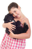 Girl holding dog — Stock Photo