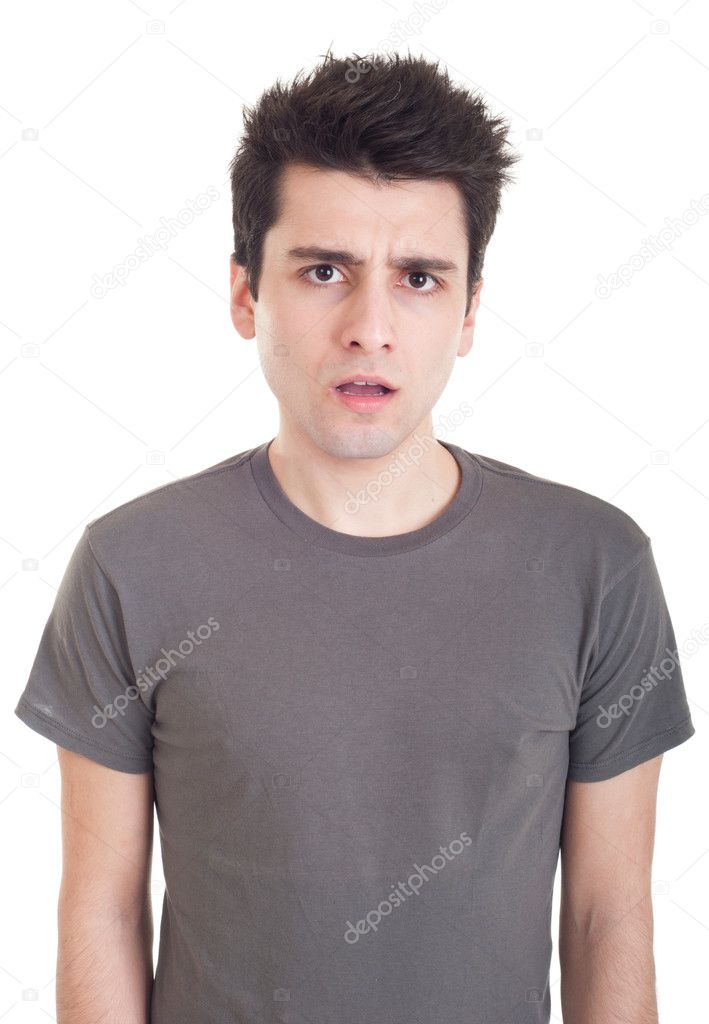 Confused young casual man with what expression (isolated on white background) — Stock Photo #5564724