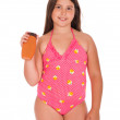 Girl in swimsuit holding sun lotion — Stock Photo