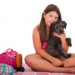 Girl in swimsuit at the beach with dog — Stock Photo