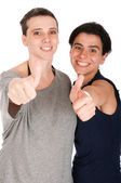 Sisters showing thumbs up — Stockfoto