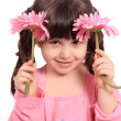 Cute little four year old girl with daisies — Foto de stock #5434502