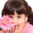Cute little four year old girl with daisy — Stock Photo