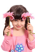 Cute little four year old girl with daisies — Stock Photo