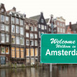 Welcome to Amsterdam sign in water — Stockfoto #5490357