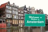 Добро пожаловать на Амстердам знак в воде — Стоковое фото