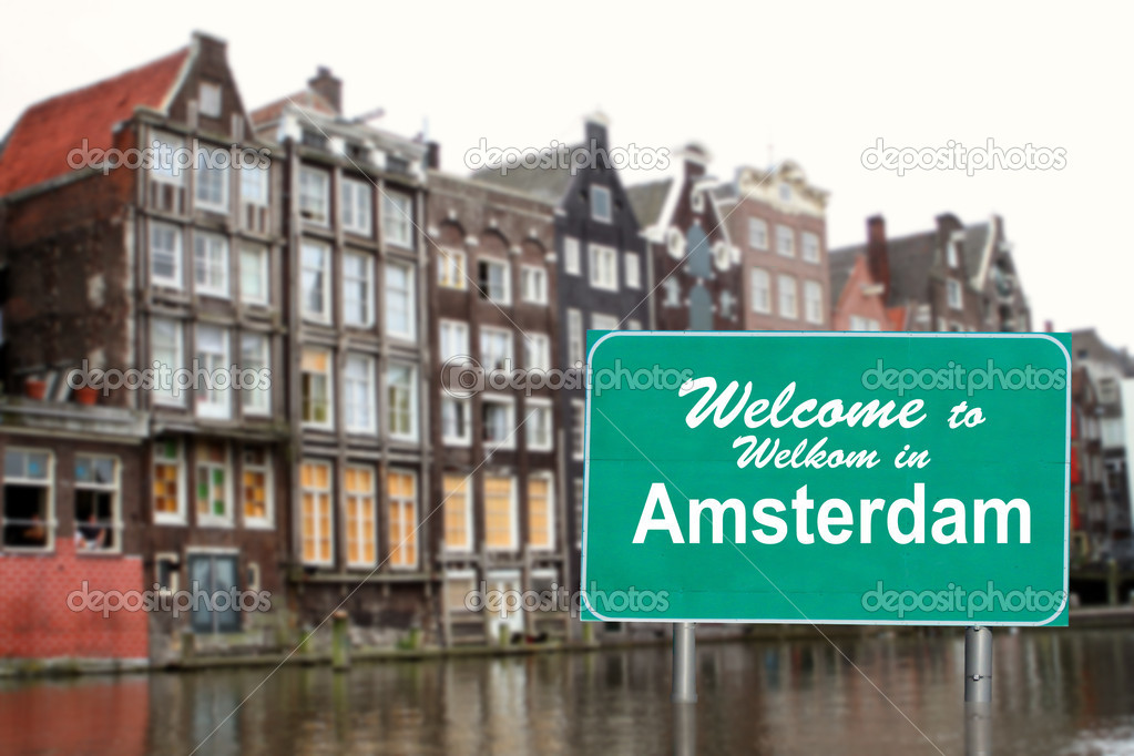 Welcome to amsterdam sign in water stock photo for Design consultancy amsterdam