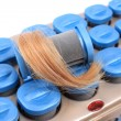 Stock Photo: Hot rollers with blonde hair