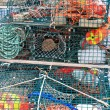 Lobster traps and colorful buoys — Stock Photo