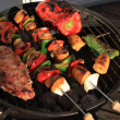 Barbecue shish kabob and steak - Stockfoto
