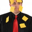 Businessman with sticky note paper on his face — Stock Photo #5983129