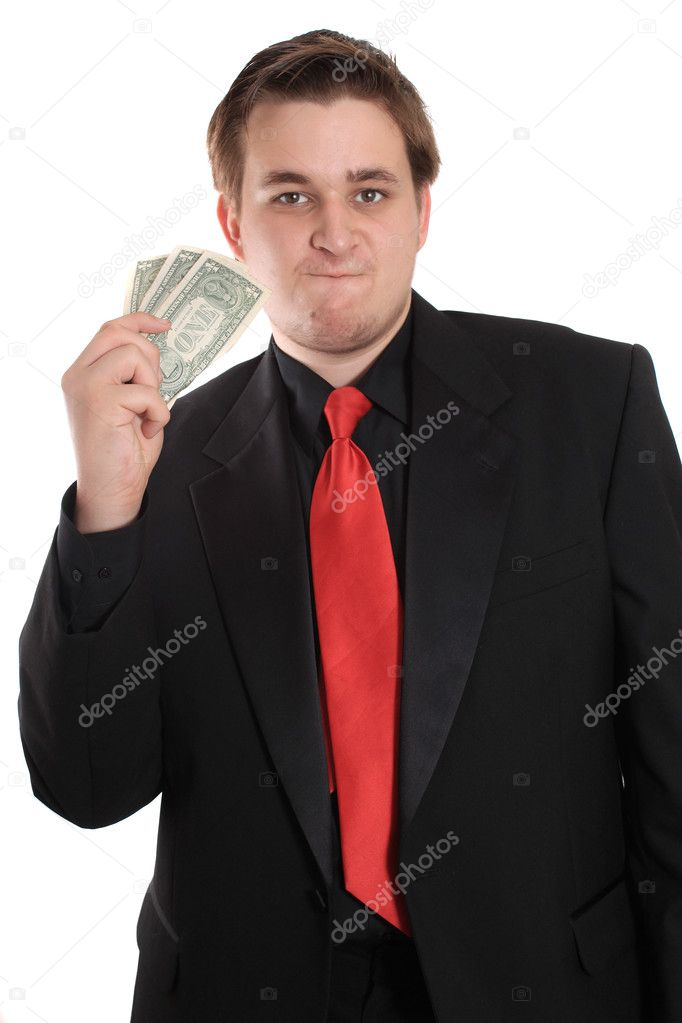 Attractive young man in black suit holding one dollar bills on a white background  Stock Photo #5990925
