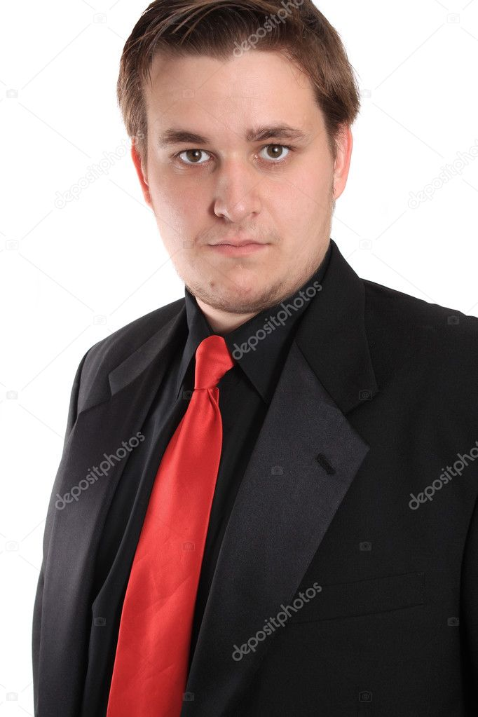 Handsome young businessman in black formal suit with red tie  Stock Photo #5990945