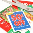 Stock Photo: Clipping coupons