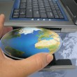 Stock Photo: World at your fingertips