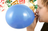 Blowing up balloon — Stock Photo