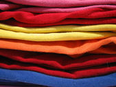 Pile of colorful tshirts — Stock Photo