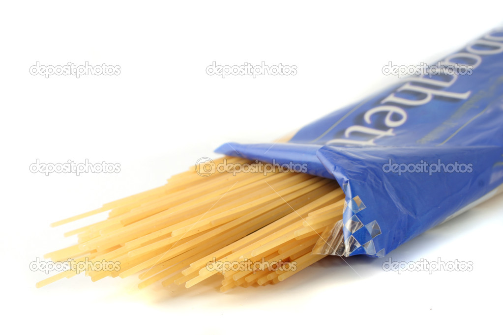 Package of spaghetti spilling out — Stock Photo #6730955