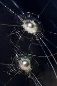 Bullet glass broken sphere — Stock Photo