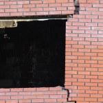 Cracked brick wall window — Stock Photo #5670555