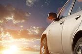 Sunset sky clouds car — Stock Photo
