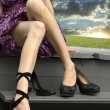 Stock Photo: Womens feet replacement shoes sunset