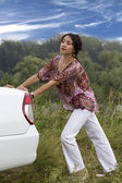 Woman propel fractured car — Stock Photo