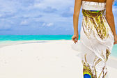 Banner of slender young woman walking alone on a beautiful beach — Stock Photo