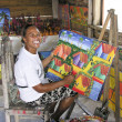 Painter Shows her Canvas in a Shop of Santo Domingo — 图库照片