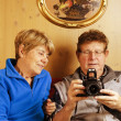 Senior Couple wathcing Pictures on the Camera — Stock Photo #6098233