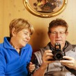 Senior Couple wathcing Pictures on the Camera — Stock Photo
