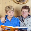 Senior Couple reading a Book, Italy — Stock Photo #6098251