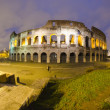 Stock Photo: Colosseum by Night in Rome, Italy